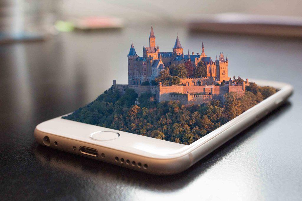 Un iPhone avec une photographie d'un château à l'intérieur.